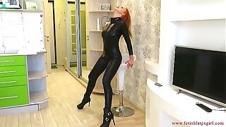Busty girl in a suit of electrical tape and catsuit spanks herself in a tight ass