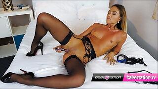 Natalia Forrest fucks herself with her glass dildo